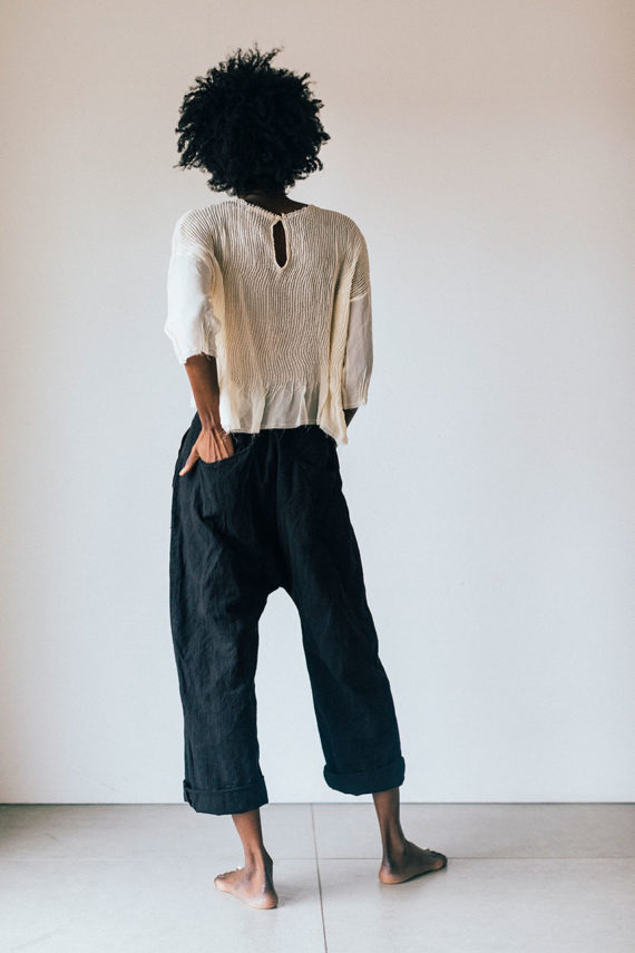 model wearing clay pants
