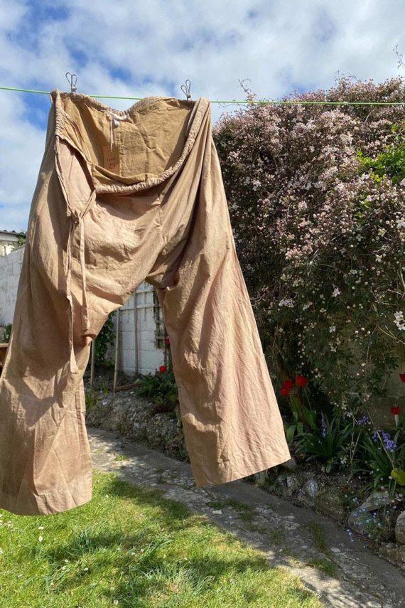sula khadi cotton Japan pants drying on washing line in garden